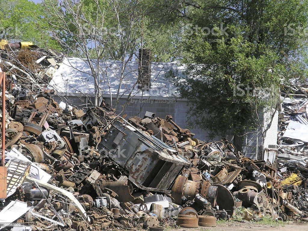 House Amid Junk stock photo