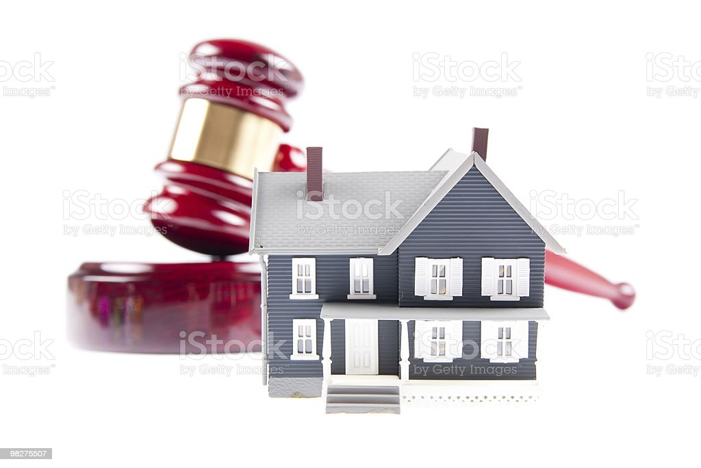 House and auction hammer symbolizing real estate royalty-free stock photo
