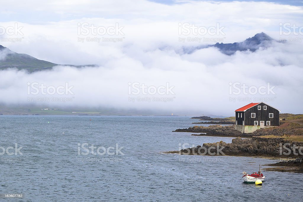 House and boat in East Iceland royalty-free stock photo