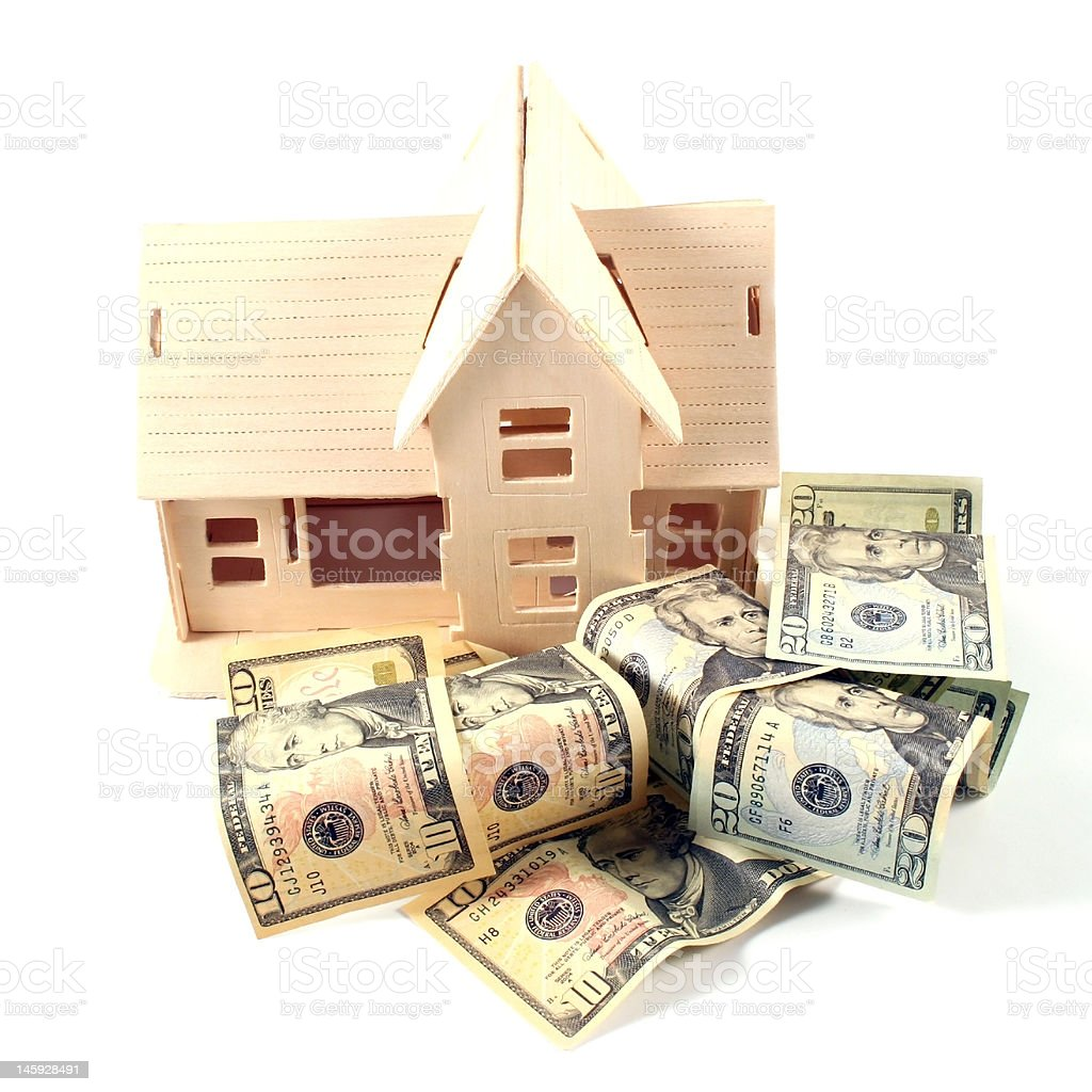 House and different dollar bills on a white background royalty-free stock photo