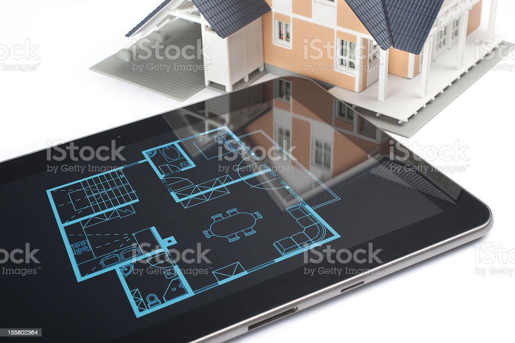 House and digital tablet royalty-free stock photo