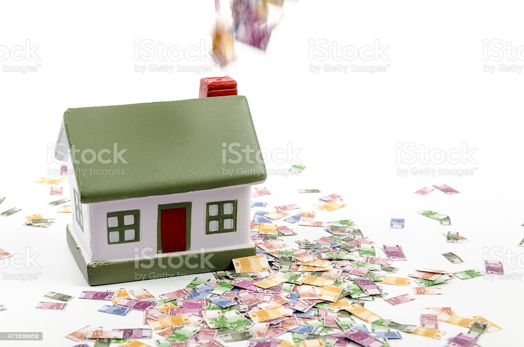 House and euro notes out of chimney stock photo