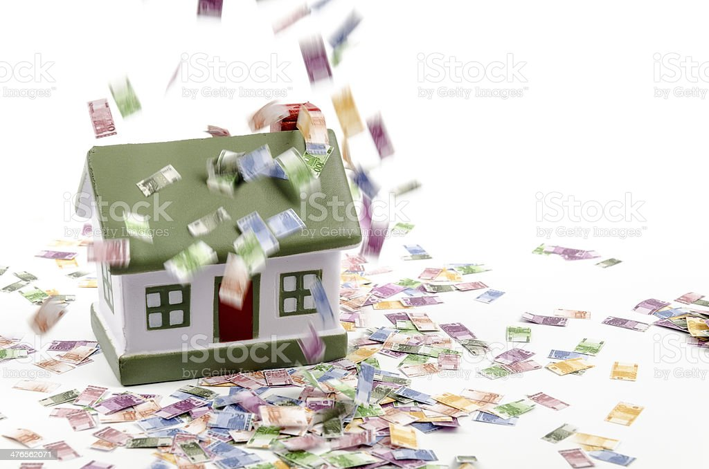 House and falling euro money stock photo
