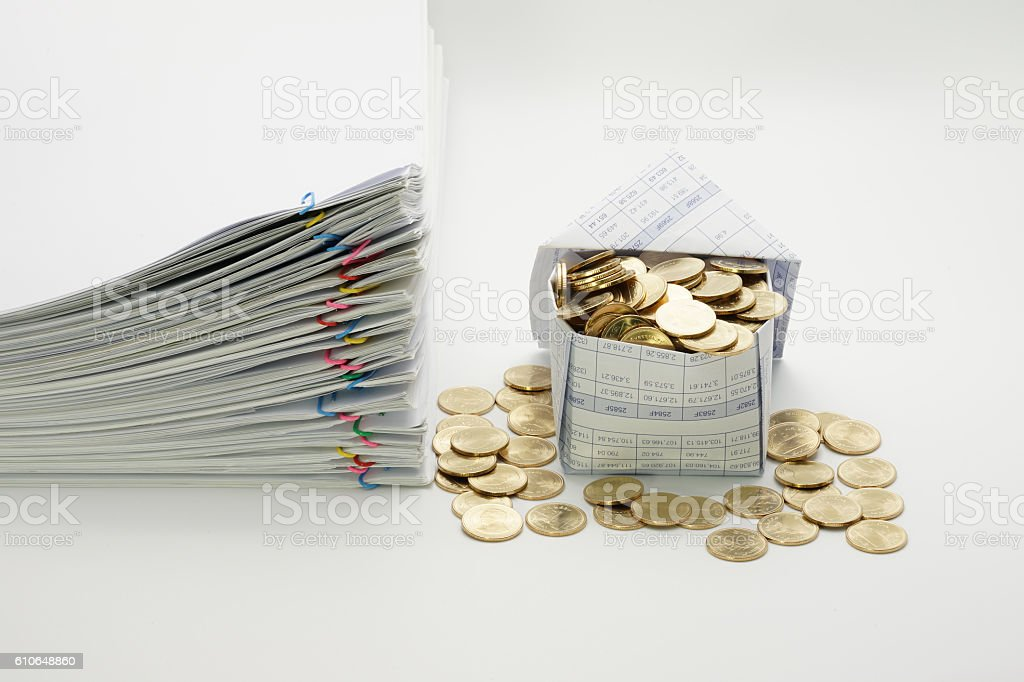 House and gold coins with pile overload document royalty-free stock photo