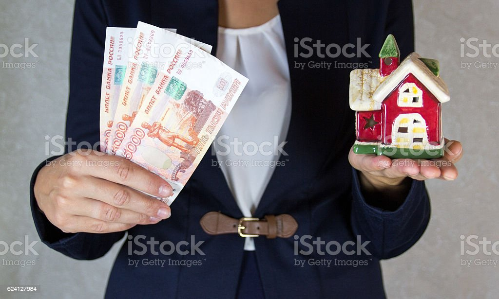 House and money in hand stock photo