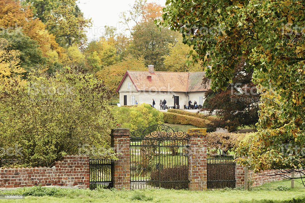 House and people in Autumn royalty-free stock photo