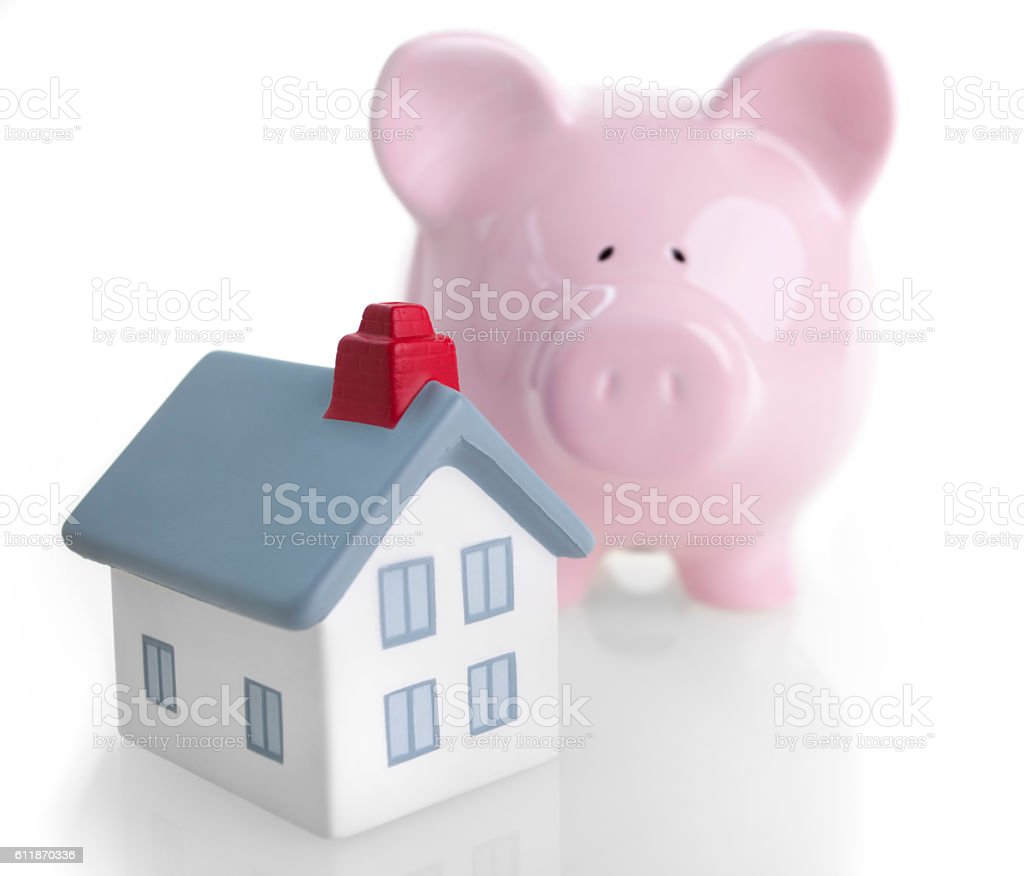 House and piggy bank, saving for a house stock photo