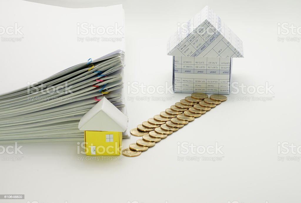 House and pile of gold coins royalty-free stock photo