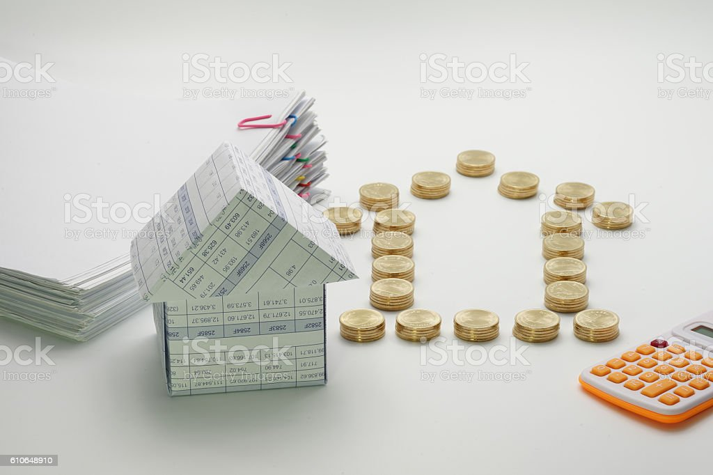 House and pile of gold coins with calculator royalty-free stock photo