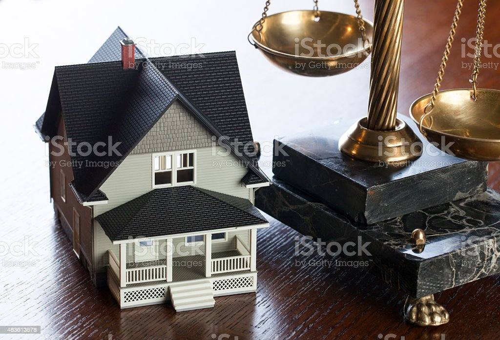House and Scales of Justice stock photo