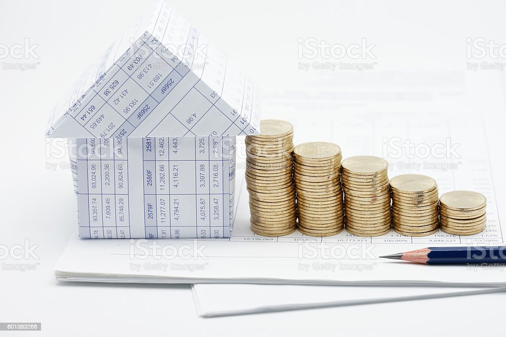 House and step pile of gold coins stock photo