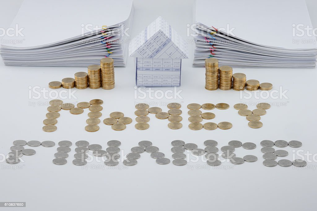 House and step pile of gold coins royalty-free stock photo