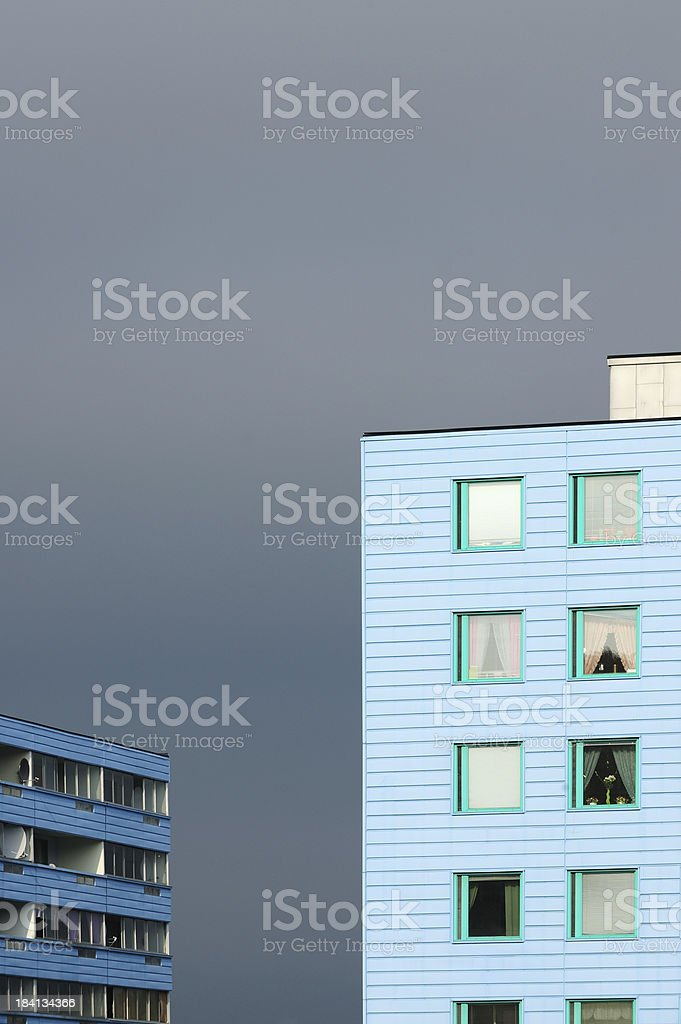 House / apartment building with balconies, dramatic sky royalty-free stock photo