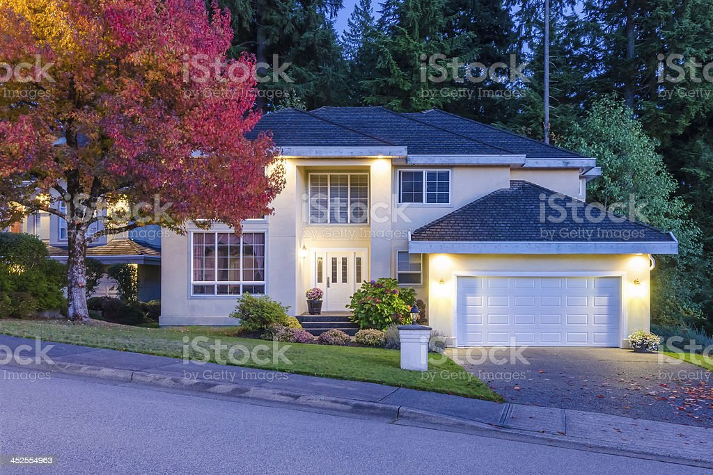 House at dusk. stock photo