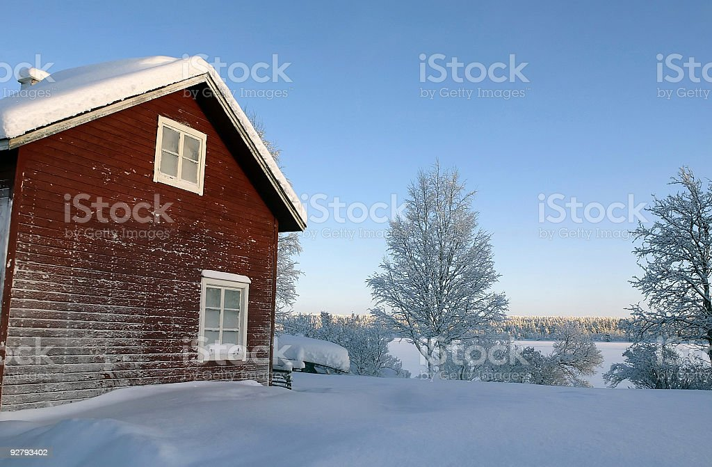House at frozen Lake / Snow in Lapland - Finland stock photo