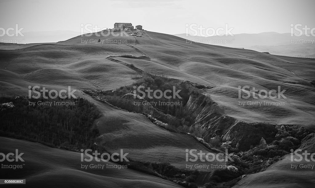 House at the top of a hill in Tuscany stock photo
