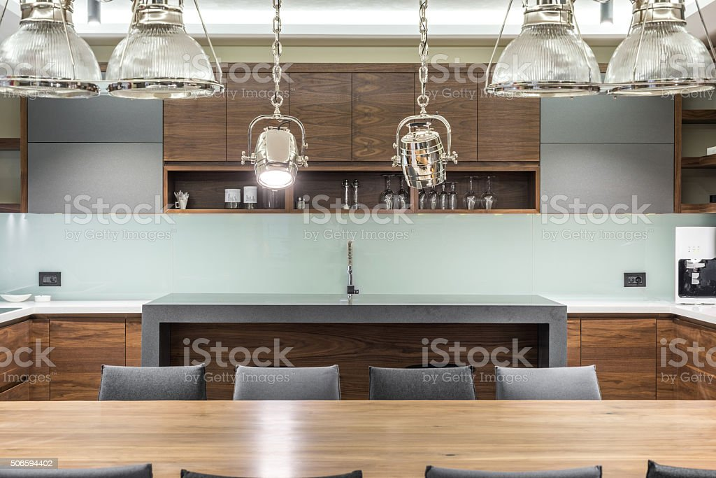 House bar with stools and two silver reflector as chandelier stock photo