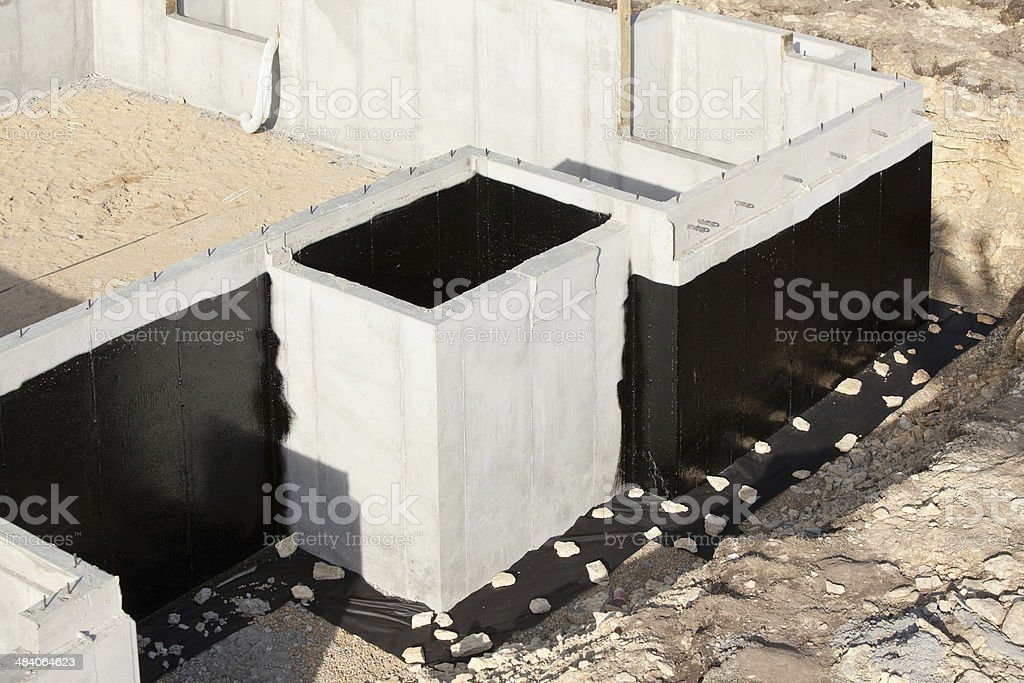 House Basement Wall Foundation with Waterproof Sealant stock photo