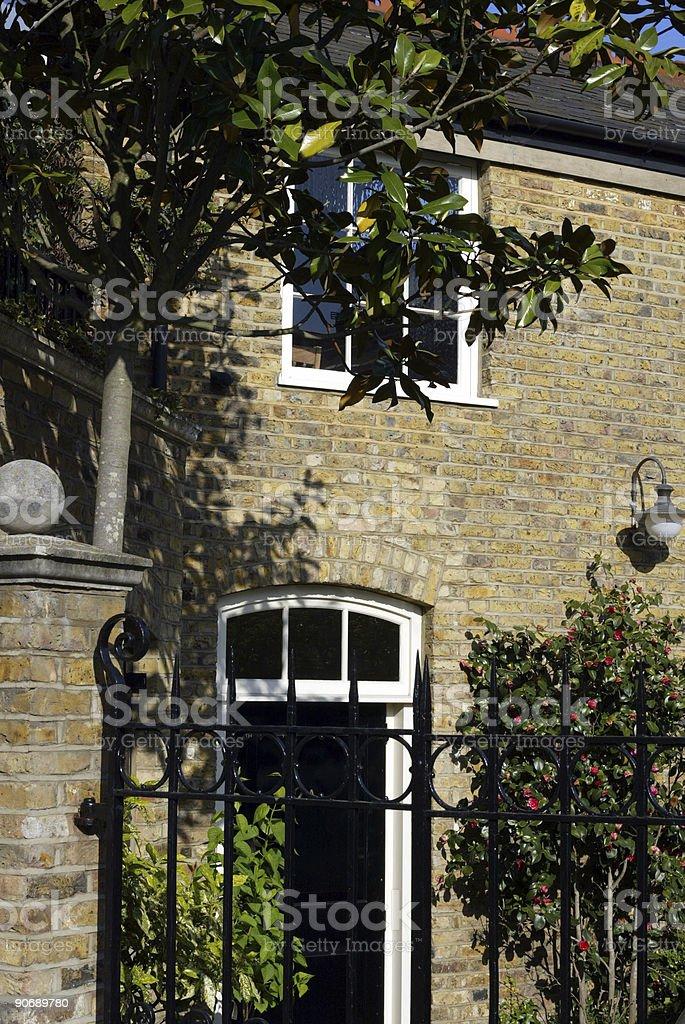 House behind gates royalty-free stock photo