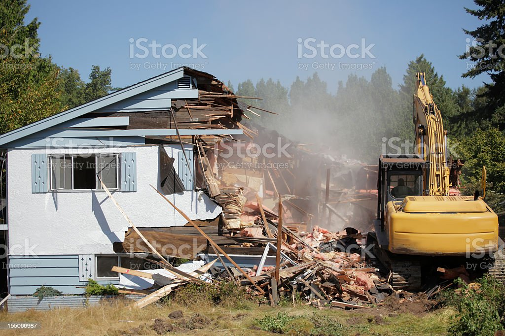 House being bulldozed in Vancouver stock photo