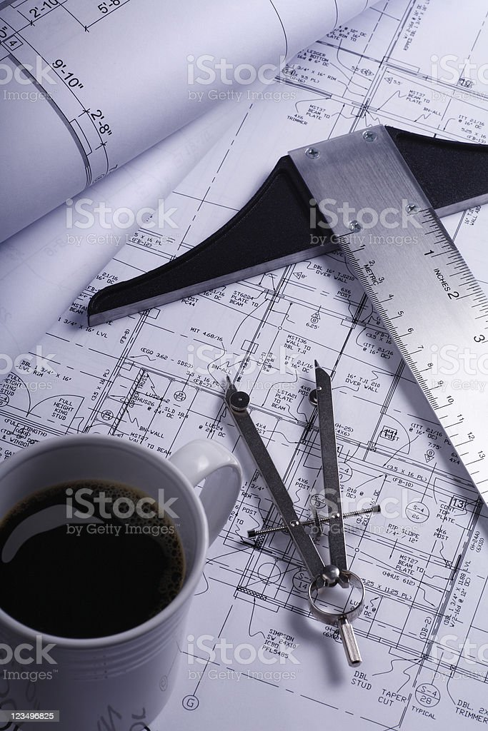 House blueprints with coffee stock photo