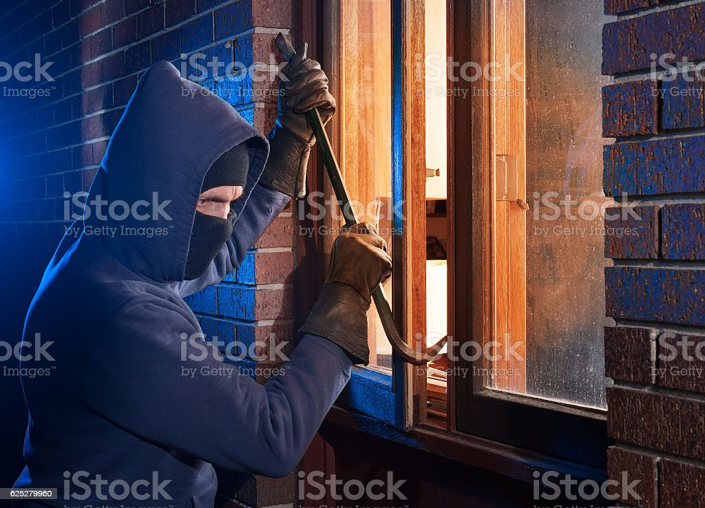 House break in by burglar stock photo