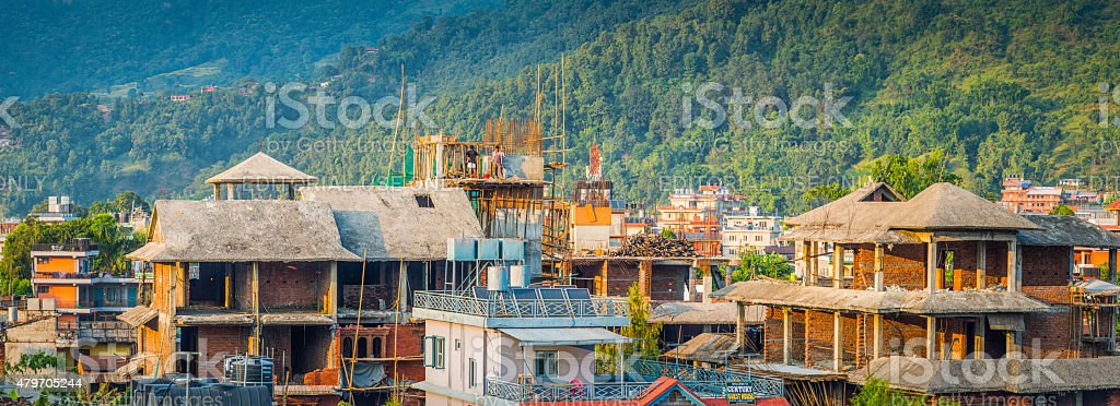 House building workers on bamboo scaffolding Pokhara panorama Himalayas Nepal stock photo