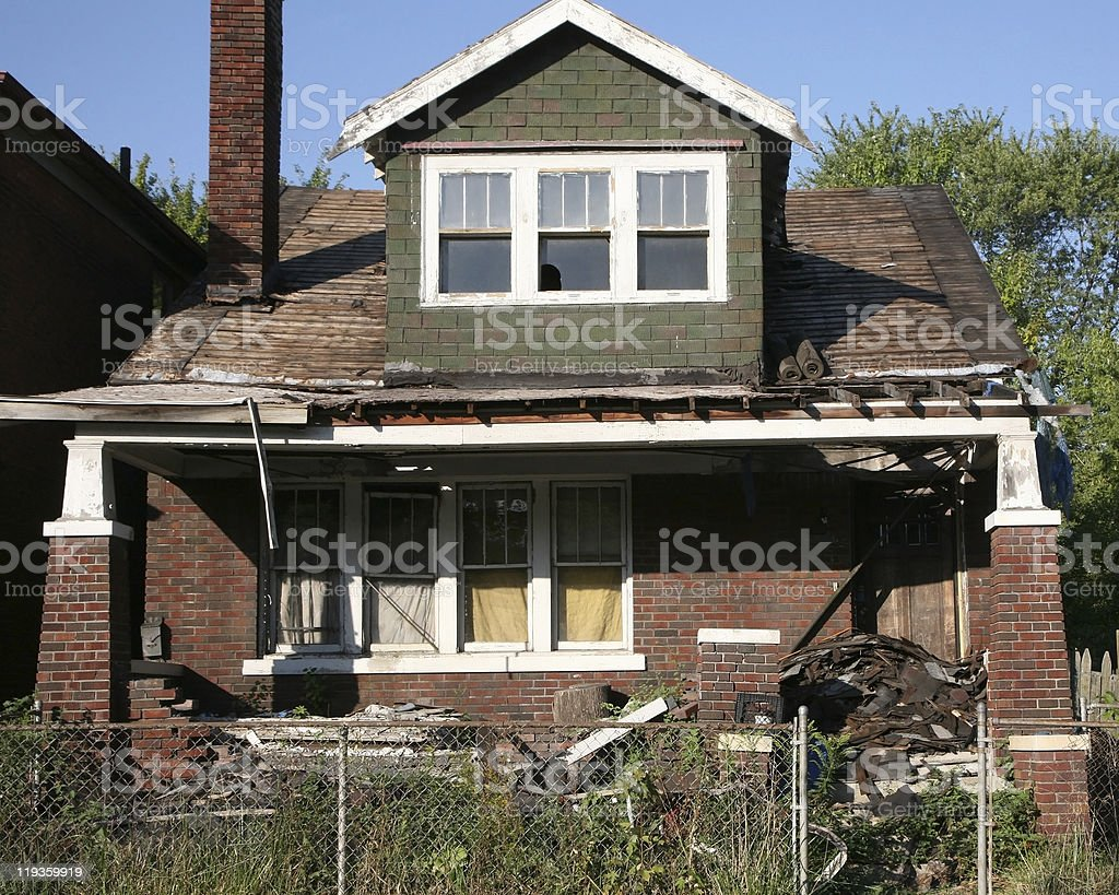 House caving in and rotting after being abandoned royalty-free stock photo