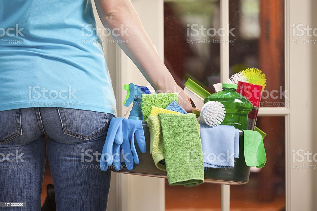 House Cleaning Kit Service Person Arriving at Customer's Home Door stock photo