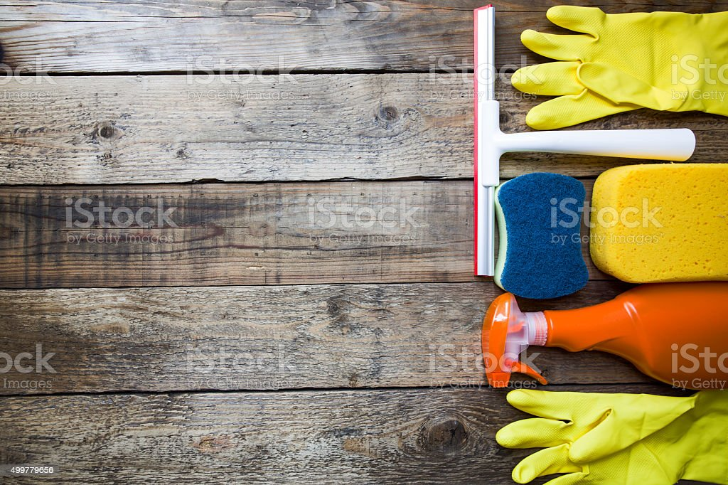House cleaning product on old wood table stock photo