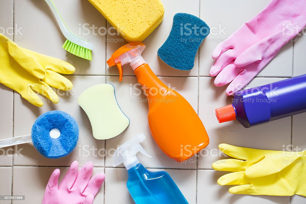 House cleaning product on tiled floor stock photo