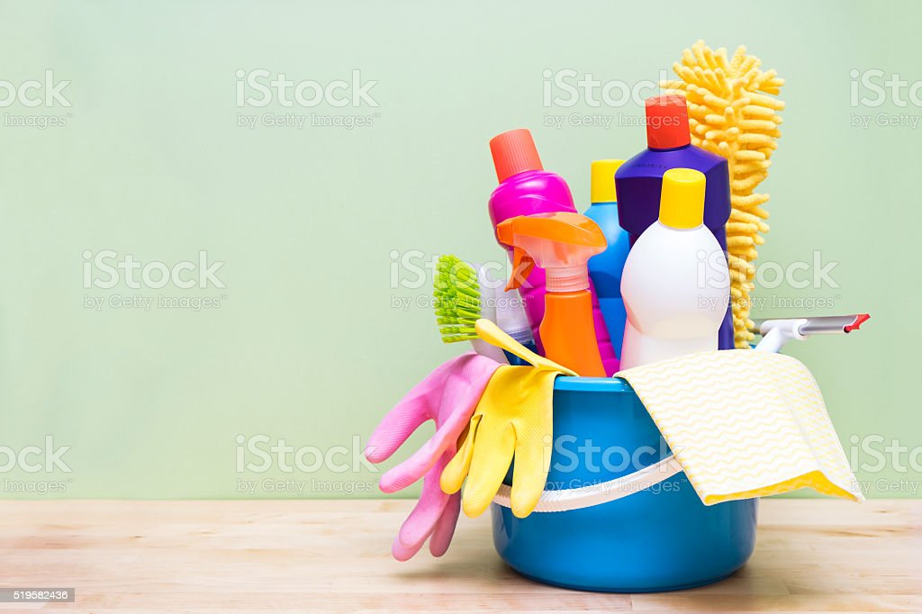 House cleaning product on wood table with green background stock photo