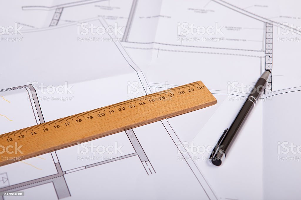 house construction plan with wooden ruler and pen stock photo