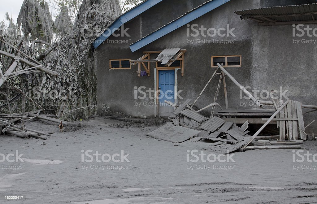 House damaged by volcano ash, Indonesia. stock photo
