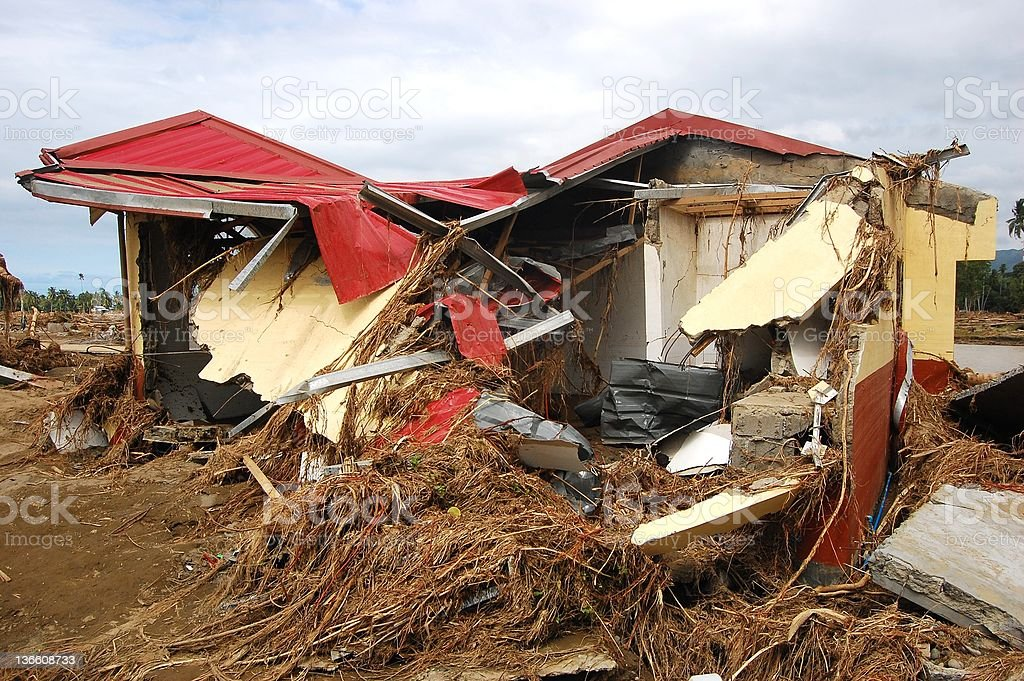 House Destroyed by Typhoon and Flood Photo stock photo