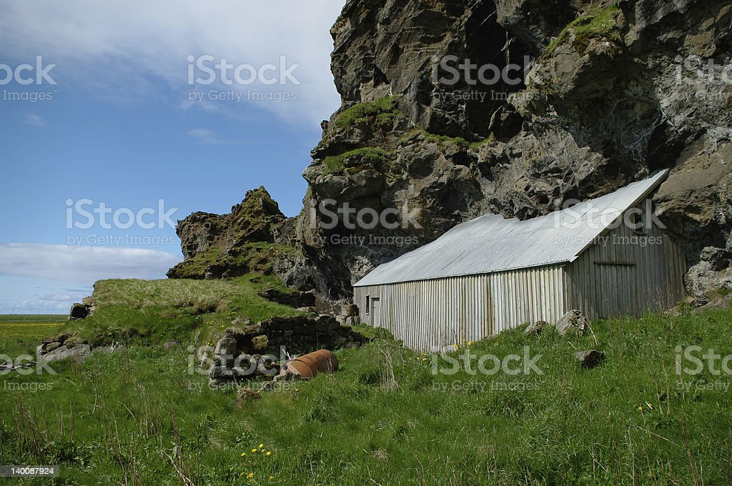 House enclosed by rocks stock photo