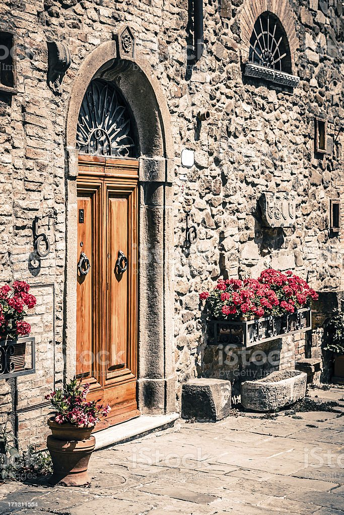House Entrance in an Old Village of Tuscany, Italy royalty-free stock photo
