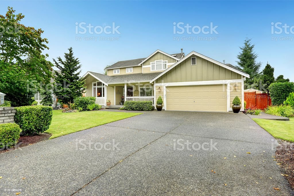 House exterior with garage and driveway stock photo