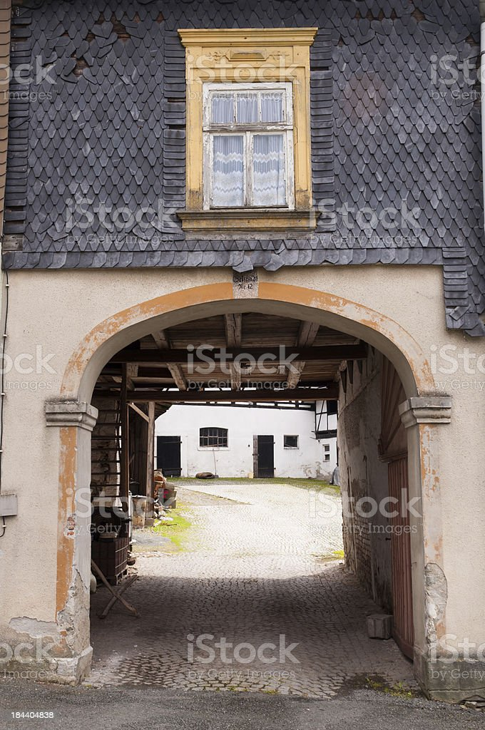 House facade with slate roof and pass to a courtyard stock photo