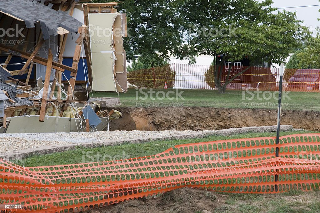 House Falling into a Sink Hole royalty-free stock photo