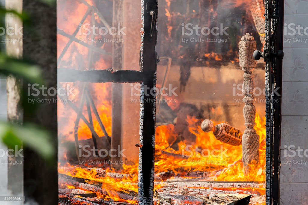 House fire in Daytime. stock photo
