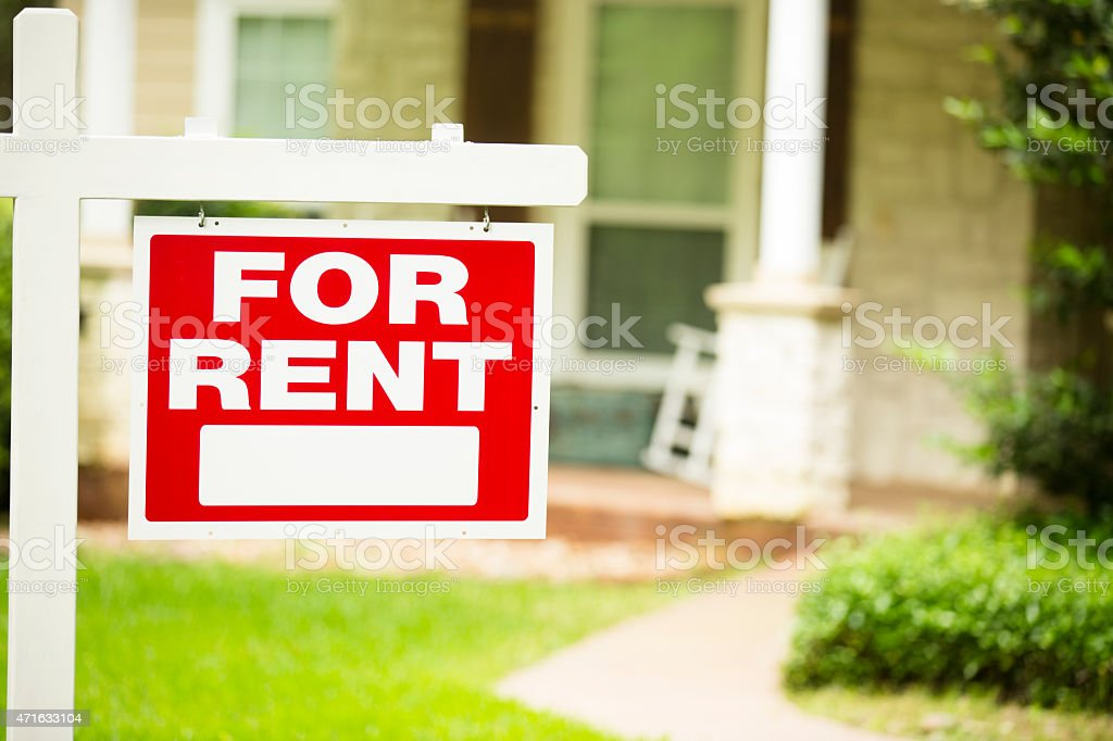 House for rent. Real estate sign. Front yard. No people. stock photo