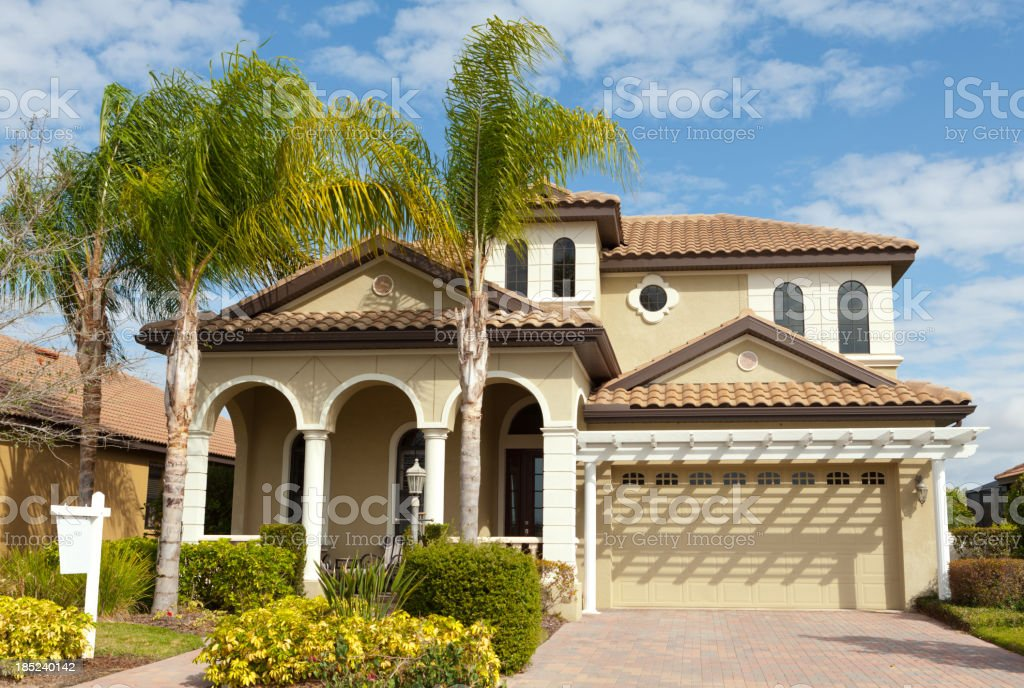 House for sale in Florida with palm trees stock photo
