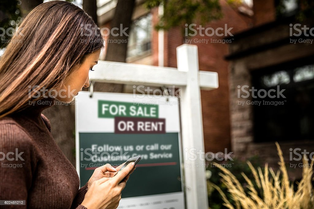 House for sale in the city downtown stock photo