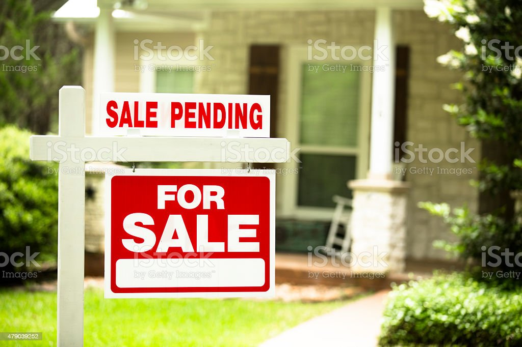 House for sale, pending sign in front yard. No people. stock photo