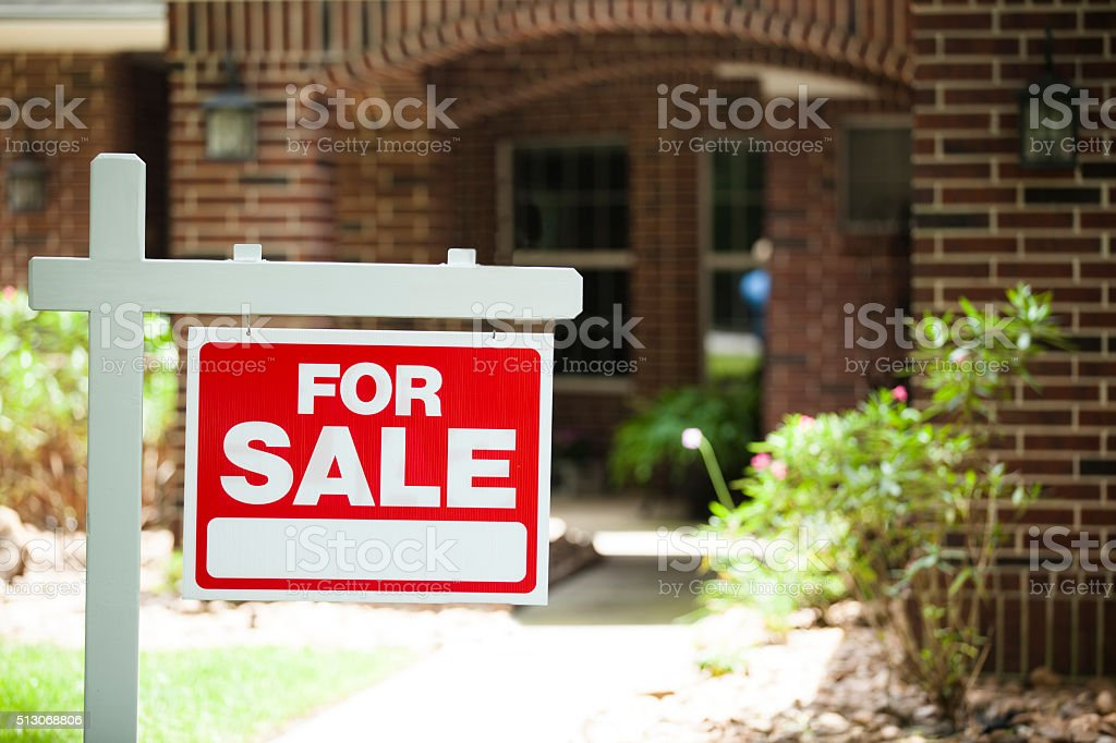 House for sale sign in front yard. No people. stock photo