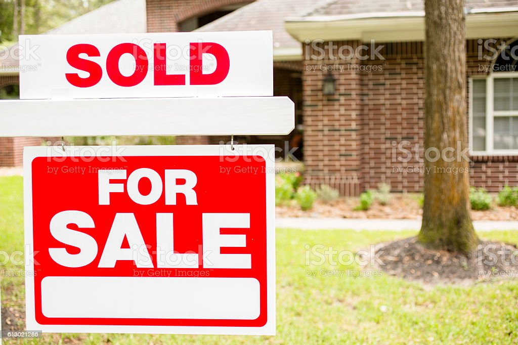 House for sale sign in front yard. stock photo