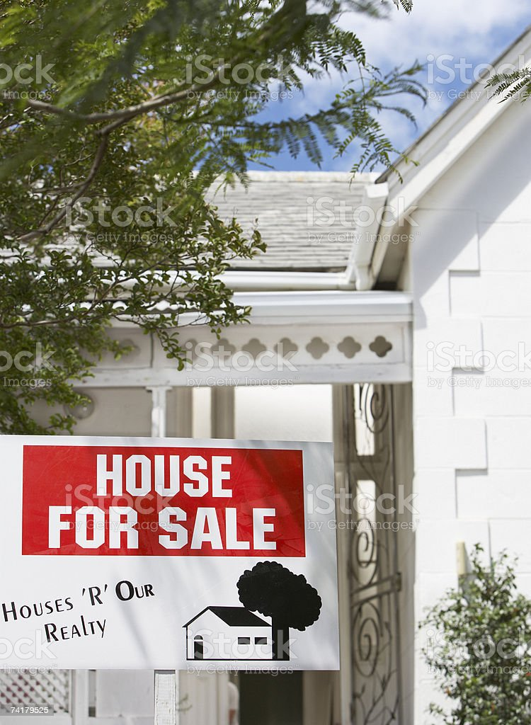House for sale sign outdoors with trees royalty-free stock photo