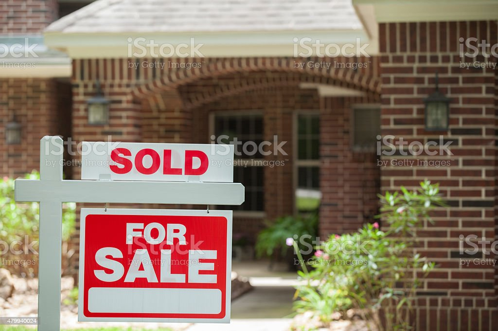 House for sale, sold sign in front yard. No people. stock photo