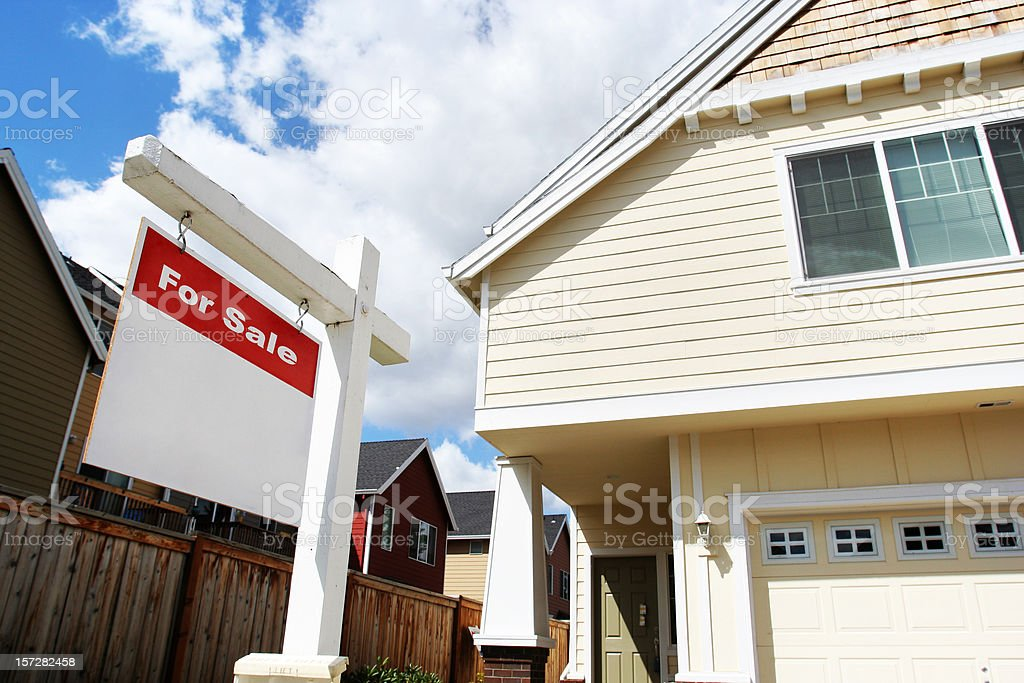 House for Sale with Red Sign stock photo